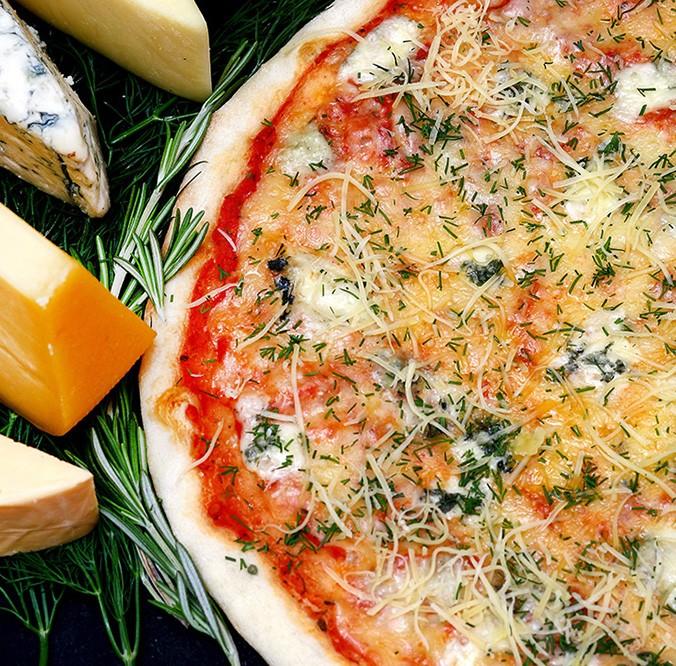 https://kalkulatorfoodcost.pl/storage//uploads/images/pizza-quattro-formagi_1606990874.jpg